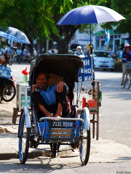 bike man in Hue, Vietnam