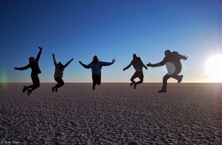 Jumping team in Uyuni Salt Flats, Bolivia